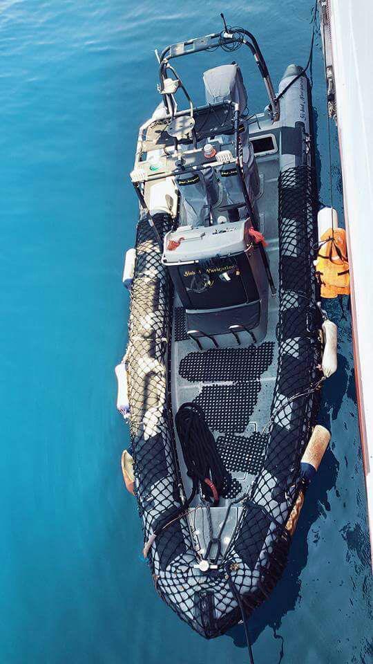 RHIB alongside mother vessel
